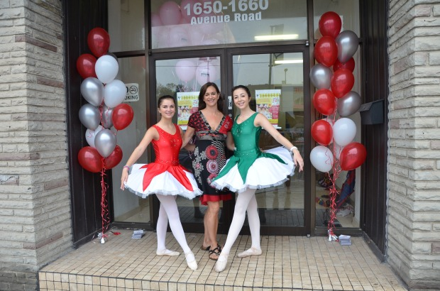 STRIKING POSES: Martha Hicks, namesake of the Martha Hicks School of Ballet, welcomed guests to her new location on Avenue Road with the help of ballerinas Danielle Filler,  left, and Nikki Richardson, right, during her grand opening party on Sept. 7.